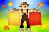 Scarecrow with bags for sale — Stock Photo