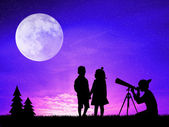 People look in the telescope — Stock Photo
