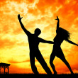 Couple dancing at sunset — Stock Photo #35002511