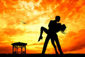 Couple dancing at sunset — Stock Photo