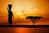 African woman at sunset — Stock Photo
