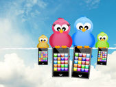 Birds with smartphones — Stock Photo