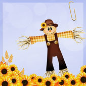 Scarecrow and sunflowers — Stock Photo