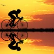 Cyclist at sunset — Stock Photo