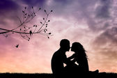 Couple kissing at sunset — Stock Photo
