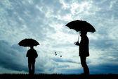 People with umbrella — Stock fotografie