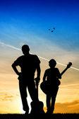 Guitarist at sunset — Stock Photo