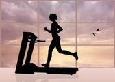Woman runs on a treadmill — Stock Photo