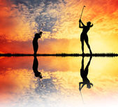 Golfers at sunset — Stockfoto