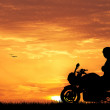 Motorcyclist at sunset — Stock Photo #48853847