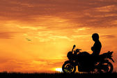 Motorcyclist at sunset — Stock Photo