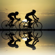 Cyclists at sunset — Stock Photo #49498845