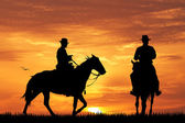 Cowboys on horse — Stock Photo