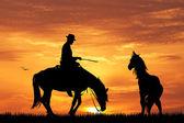 Rodeo cowboy at sunset — Stock Photo