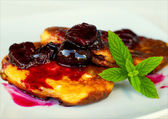 Cheese pancakes with cherry syrup — Stock Photo