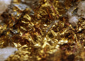 Abstract fantastic background from a golden metal colour surface — Foto de Stock