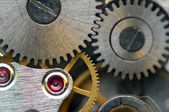 Metallic Background with metal cogwheels a clockwork. Macro — Stock Photo