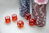 Poker chips with dice — Stock Photo