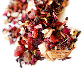 Aromatic dry tea with fruits and petals — Stock Photo