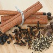 Stock Photo: A set of spices on wooden cutting board close up