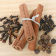 A set of spices close up on a wooden cutting board. — Stock Photo