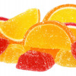 Handful of orange and yellow candy — Stock Photo
