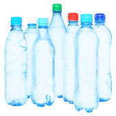 Set blue bottles with water isolated — Stockfoto