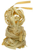 Durum wheat semolina pasta with spinach tower close up — Stock Photo