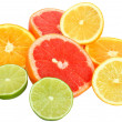 Cut heap lime, grapefruit, lemon and orange — Stock Photo