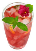 Fruit cocktail decorated with flower violet — Stock Photo
