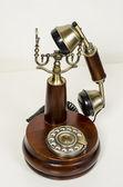 Old fashioned telephone isolated on white background. Studio work. — Stock Photo