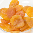 A pile of dried apricots on a white background — Stock Photo #41673775