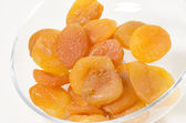 A pile of dried apricots on a white background — Stock Photo