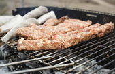 Meat on grill — Stock Photo