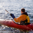 Kayaker in the sea - Stock Photo