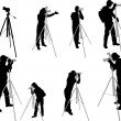 Photographers silhouettes — Stock Vector