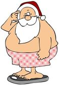 Santa standing on bathroom scales — Stock Photo