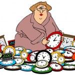 Woman setting clocks — Stock Photo #34883123