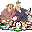 Husband & wife setting clocks — Stockfoto