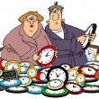Husband & wife setting clocks — Stok fotoğraf