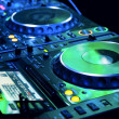 DJ CD player and mixer - Stock Photo
