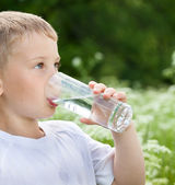 Child drinking pure water — Stock Photo