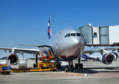 Airplane is being serviced — Stock Photo