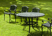 Cast iron chairs and table — Stock Photo