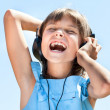 Happy little girl in headphones — 图库照片