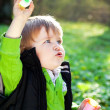 Stock Photo: Little boy with soap bubbles