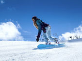 Snowboarder moving down — Stock Photo
