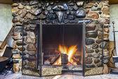 Stone fireplace — Stock Photo