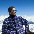 Portrait of smiling man at ski resort — Stock Photo
