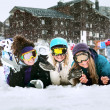 Young girls are snowboarders in mountains — Stock Photo